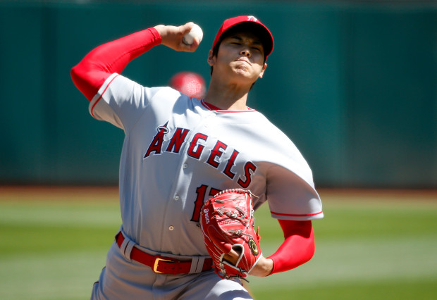 From The Mercury News: Shohei Ohtani of the Los Angeles Angels (17) pitches in the first inning of his his first MLB start against the Oakland Athletics at the Oakland Coliseum in Oakland, Calif., on Sunday, April 1, 2018. (Karl Mondon/Bay Area News Group)