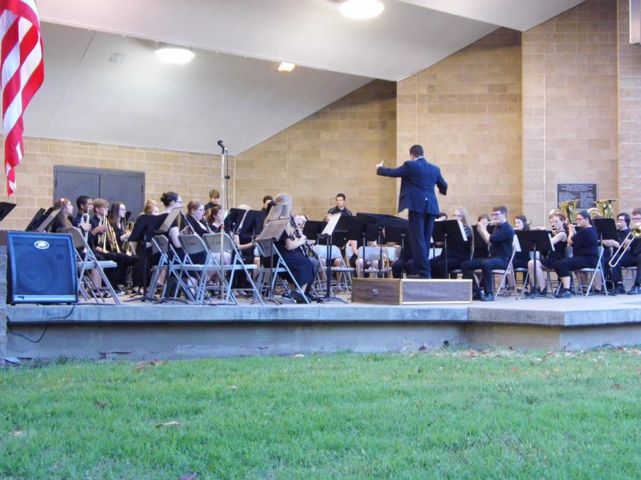 Director Aaron Tompkins instructs Wind Ensemble through The Rebellion is Reborn.