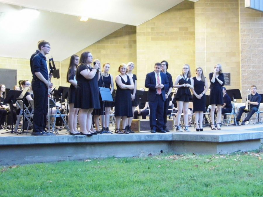The band's graduating seniors donated two new stands and an ocean drum as a departing gift.