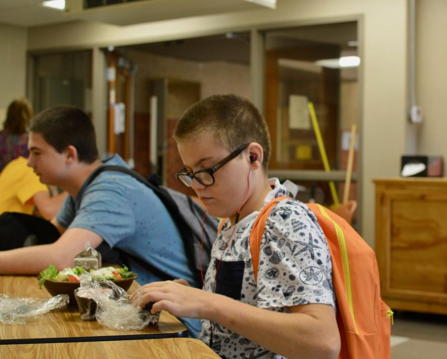 Freshman Logan Rhodes gets ready to eat his salad.