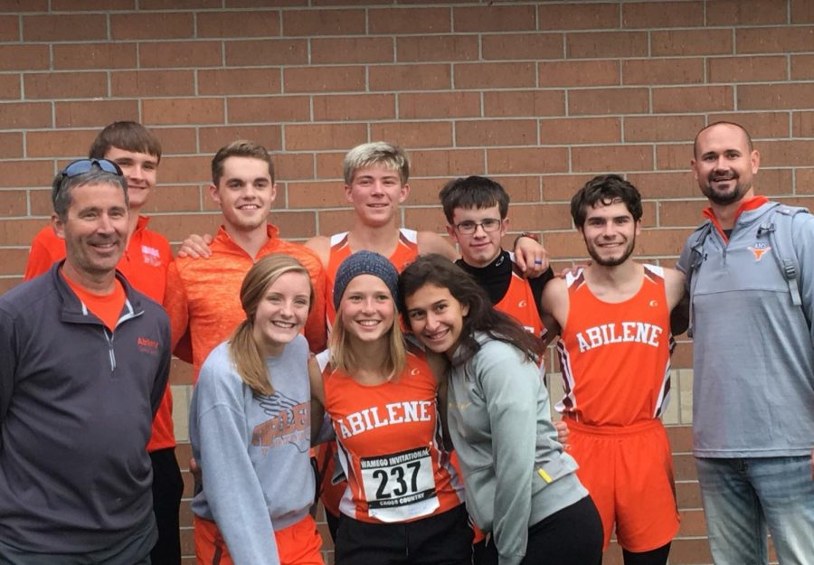 The seniors following their final race. From left to right, they are; BACK ROW: Austin Wuthnow, Damian Hartman, Braydon Surritte, Travis Luthi, Lucas Cook, and coach Tyler Bryson. FRONT ROW: Coach Andy Cook, Sydney Burton, Abby Barnes, and Megan Anguiano. (PHOTO: Kristi Cook)