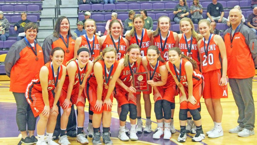 Vopat (front row, far left) with the girls' basketball last season after their third place finish in the SIT.