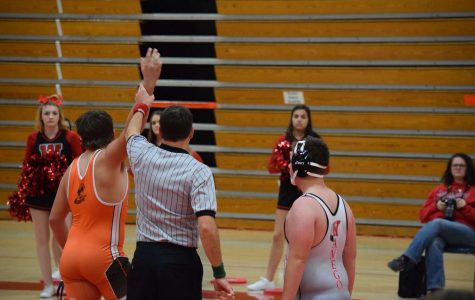 Cowboy's Karsen Loader gets hand raised after a pin victory in Wamego.