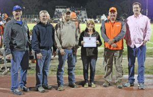 Justin Clark, middle, receiving the National Athletic Trainers' Association (NATA) Safe Sports School award.