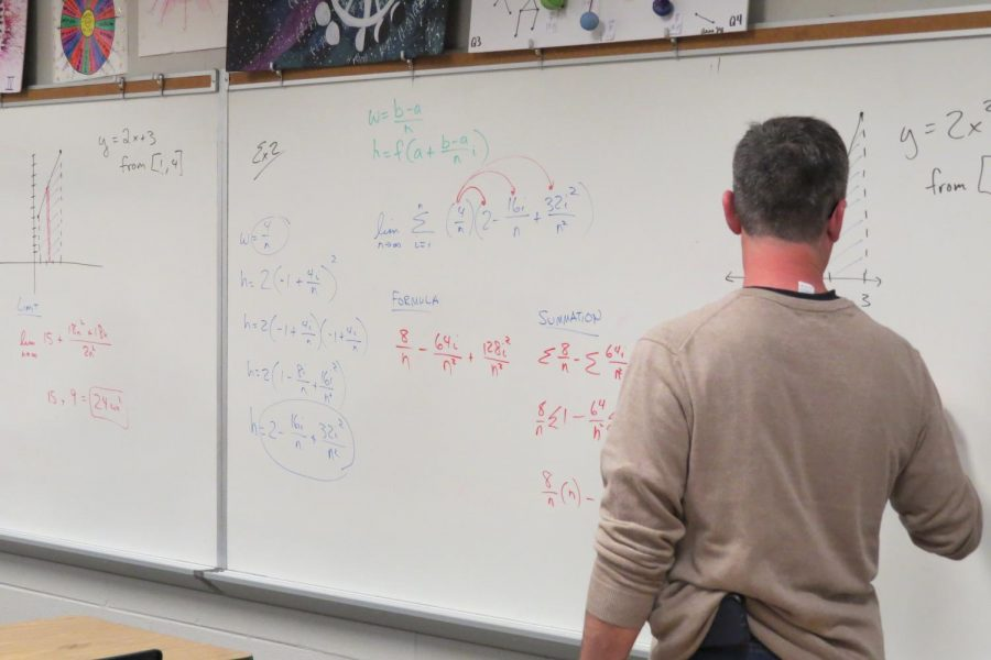 Mr. Cook details his lesson for his third block Calculus class.