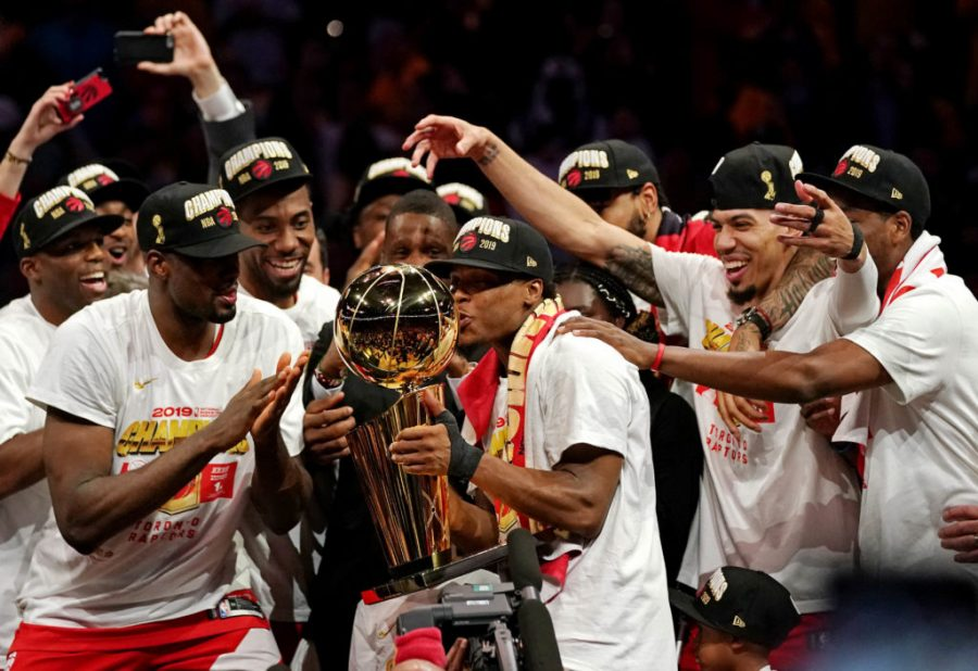 Jun 13, 2019; Oakland, CA, USA; Toronto Raptors guard Kyle Lowry (7) kisses the Larry O'Brien Trophy after beating the Golden State Warriors in game six of the 2019 NBA Finals at Oracle Arena. Mandatory Credit: Kyle Terada-USA TODAY Sports