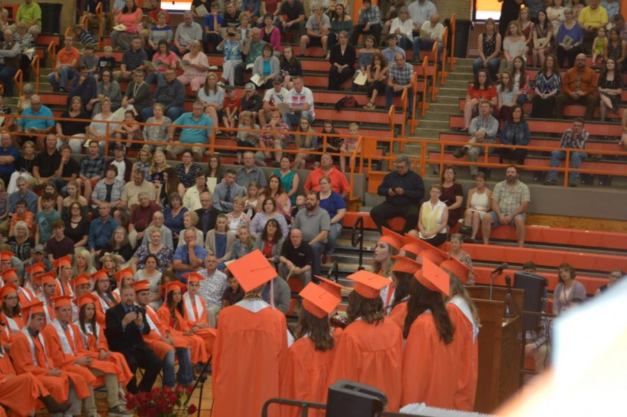 Senior Choir and Singers members begin graduation singing Never Grow Up by Taylor Swift
