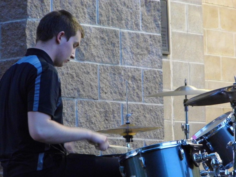 Junior Grant Weishaar plays the drums to