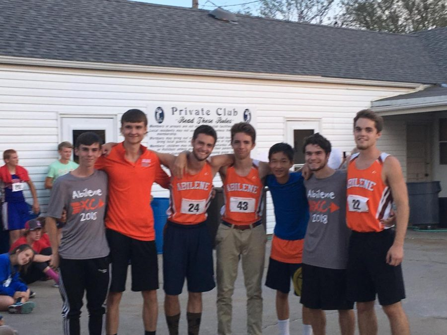 Triston (far left) with the rest of the varsity cross country team following a meet in 2018.