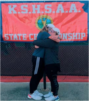Olberding (left) and Kylie Coup (right) share a hug after their season ends.