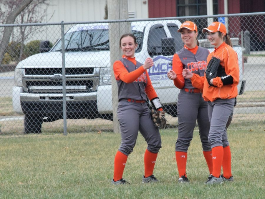 Jade, left, with Rylie Volkman and Kayley Taylor, during a softball scrimmage.