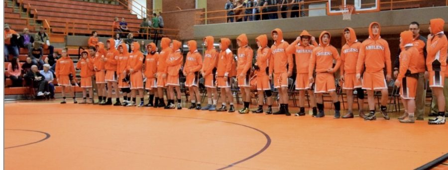 Last years wrestlers pose for the camera after a match.