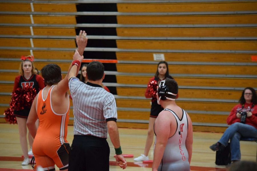 Cowboy%27s+Karsen+Loader+gets+hand+raised+after+a+pin+victory+in+Wamego.