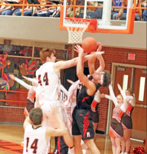 Preston Boyd (44) engages in a rebound battle against Marysville.