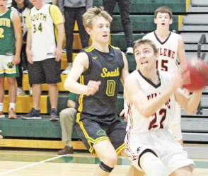 Travis Beetch, 22, fails to score an underneath basket against Salina South as Tim Barbieri (15, back) watches.