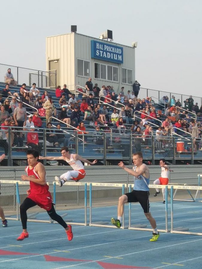 Triston Stover (left) leads Jonathan Ritchie (right) in a leg of the 110 meter hurdles at Riley County.