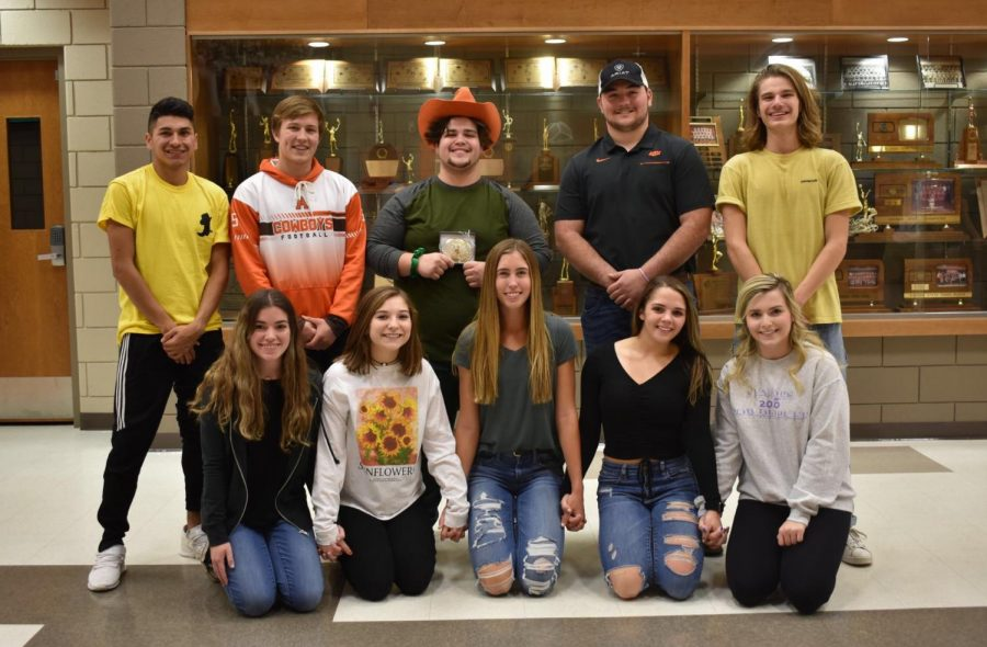 Cowboy Joe winner Adam Henely poses with fellow candidates Christian Radabaugh, Jackson Randles, Kade Funston, and Josh Young, with campaign managers Taylor Heitschmidt, Aly Johnson, Shiann Olberding, Savannah Stout, and Anna Zey.