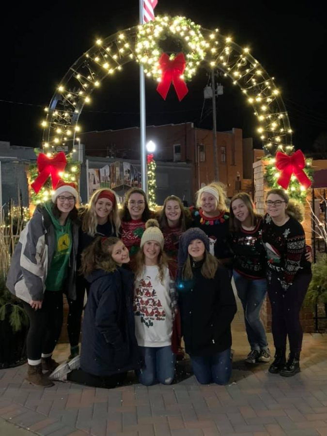 Winter Magic: The AHS Singers get into the Christmas spirit caroling around downtown Abilene.